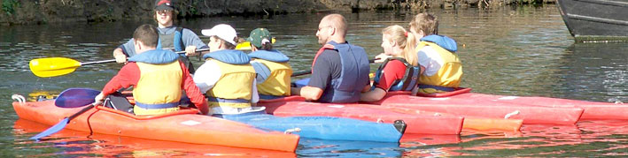 a novice coaching group on the water